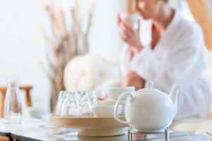 Woman drinking tea in wellness spa